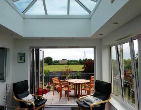 Orangery by Mendip Conservatories with a lantern roof, bi-fold doors and open-in window installed in Somerset