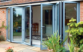 Grey bi-fold doors partialy open